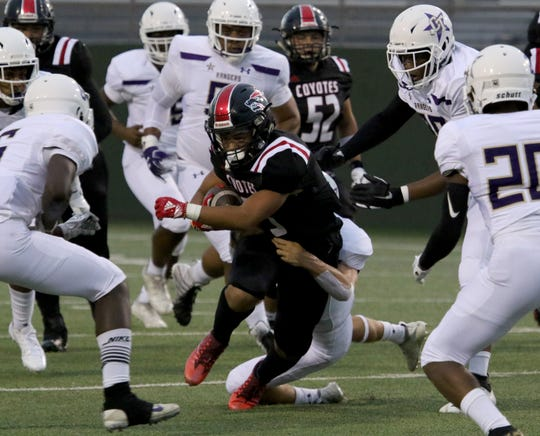 Wichita Falls High's Khelyn Sapp is tackled by Chisholm Trail's CJ Newton Thursday, Aug. 29, 2019, at Memorial Stadium.
