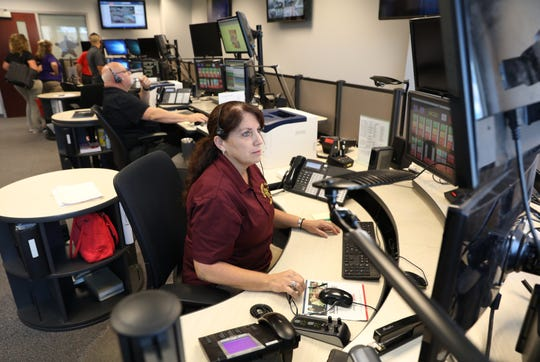 Muskingum County Dispatcher Shelly Garey works at her desk at the Muskingum County Sheriff's Office. Garey has been a dispatcher with the county for 24 years.