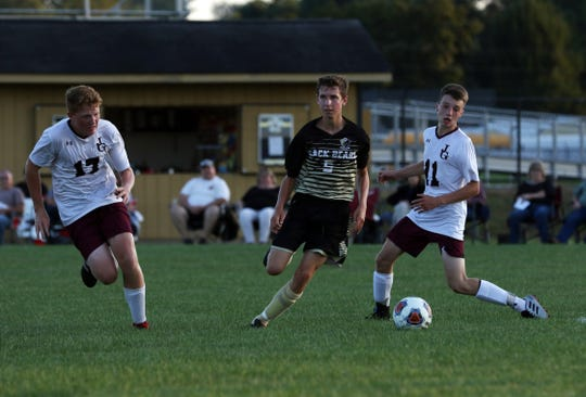 River View's Caleb Shriver moves with the ball against John Glenn.