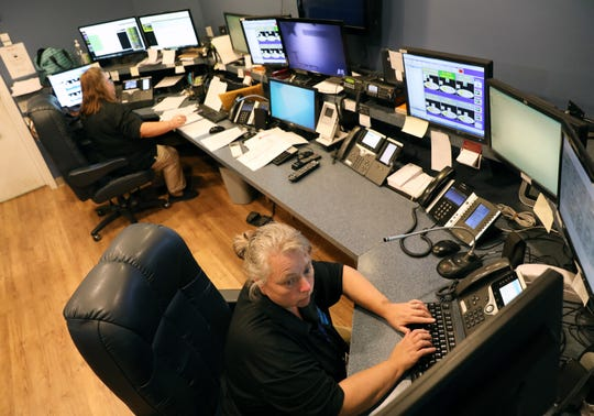 Shelly Lewis, a dispatcher with the City of Zanesville, takes a call at the city's dispatch center.