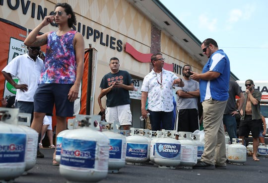 People wait in line at a U-Haul store to fill their propane tanks before the possible arrival of Hurricane Dorian on August 30, 2019 in Boynton Beach, Fla.