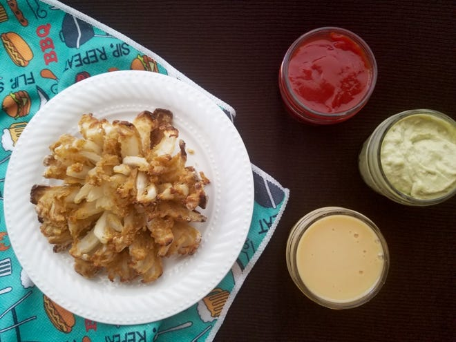 Healthier Bloomin' Onion with 3 dipping sauces.