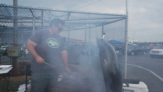Watch which way the wind blows and maneuver your grill to make sure the smoke doesn't hit your guests, Shanley recommends.