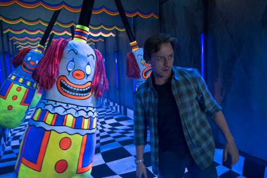 "Bill (James McAvoy) faces more than one clown in a frightful funhouse sequence in ""It: Chapter Two."""