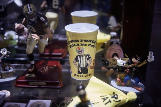 Tony Le Mon has a cup in his home commemorating the referee's infamous blown call that likely cost the Saints a trip to the Super Bowl last season.