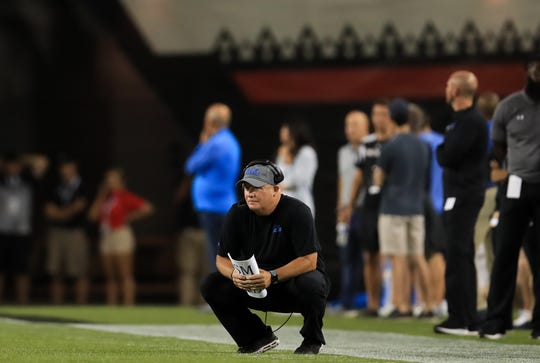 UCLA coach Chip Kelly watches his team from the sidelines during the second half against Cincinnati.