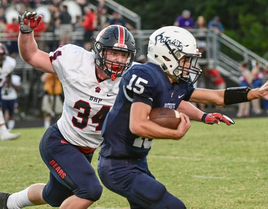 Belton-Honea Path senior Will Blackston(34) tackles Powdersville Cole Bracken(15) during the first quarter at Powdersville High School Friday, August 30, 2019.