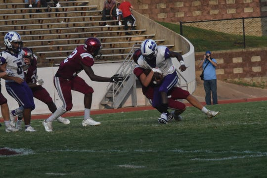 Montgomery receiver J.T. Turner (1) fights for yards during the Cenla Jamboree last season.