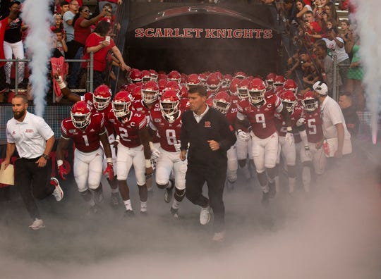 Rutgers Head Coach Chris Ash leads his team out for first game. Rutgers-UMass football season opener at SHI Stadium in Piscataway on August 30, 2019.