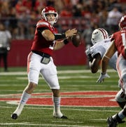 Rutgers quarterback Mclane Carter launches one down field during first half action. Rutgers-UMass football season opener at SHI Stadium in Piscataway on August 30, 2019.