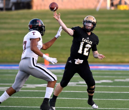Abilene High quarterback Eric Abbe passes over Amarillo Tascosa linebacker Chris Sunn-Solis during the season-opening game Aug. 30 at Shotwell Stadium. Tascosa won 19-14. Abbe, who also handled the team's punting chores, was a third-team all-state pick as a punter on the Texas Sports Writers Association's Class 6A team, which was released Saturday.