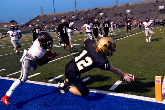 Eagles quarterback Eric Abbe stretches for the goal marker after being knocked out of bounds by Tascosa defensive back Major Everhart during Friday's season opener for Abilene High at Shotwell August 30, 2019. Tascosa won, 19-14.