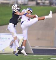 Cooper's Dylon Davis picked off a Keller pass in the first quarter during the Cougars season opener Aug. 30 at Keller ISD Athletic Complex.