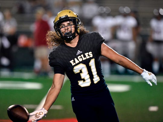 Abilene High linebacker Jorge Hernandez tosses the ball to an official after recovering it from a Tascosa fumble Friday at Shotwell Stadium August 30, 2019. Tascosa won, 19-14.