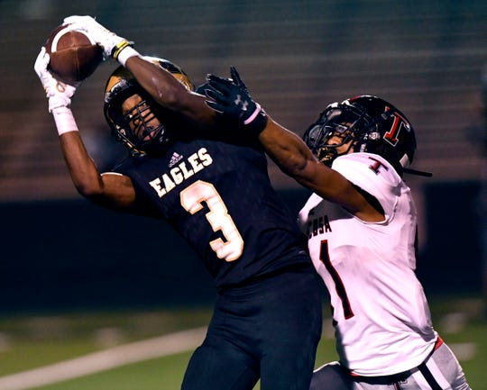 Abilene High wide receiver Tre Phillips successfully catches a pass despite the coverage provided by Tascosa's Dantrail Gilbreath Friday at Shotwell Stadium August 30, 2019. Tascosa won, 19-14.