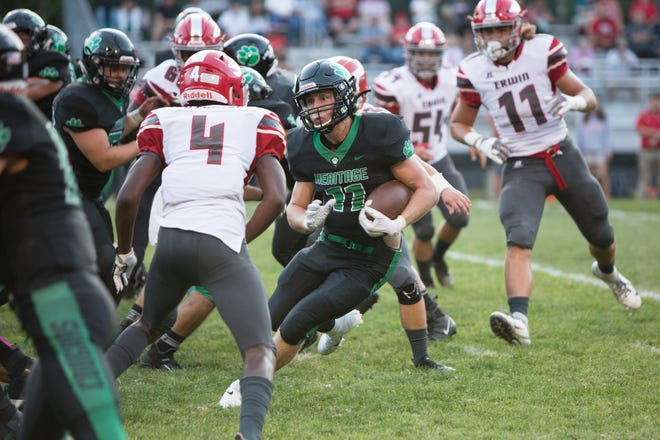 Bailey Johnson of Mountain Heritage ran the ball as Mountain Heritage faced off against Erwin at home on Aug. 30, 2019.  Mountain Heritage won the game, with a final score of 24-3.