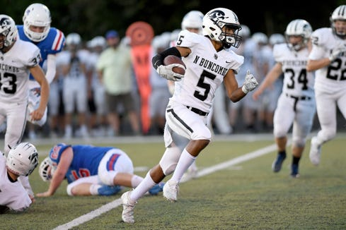 North Buncombe's Christian King runs the ball against Madison during their game at Madison High School on Aug. 30, 2019.