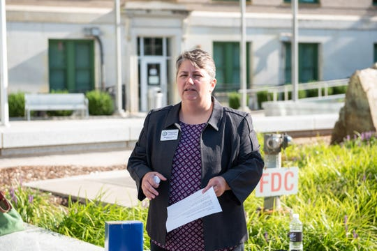 April Burgess-Johnson, executive director of Helpmate, speaks at a vigil held Aug. 30, 2019, at Buncombe County Courthouse to honor a recent victim of domestic abuse.