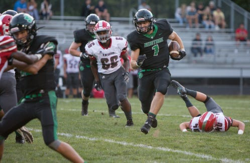 Cole Shehan of Mountain Heritage ran the ball as Mountain Heritage faced off against Erwin at home on Aug. 30, 2019.  Mountain Heritage won the game with a final score of 24-3.