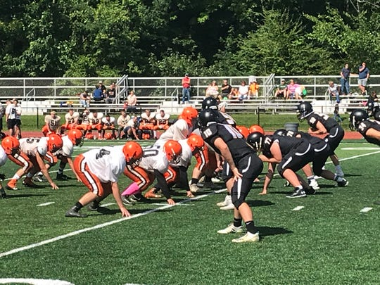 Walton prepares to run a play against host Windsor during a scrimmage Saturday.