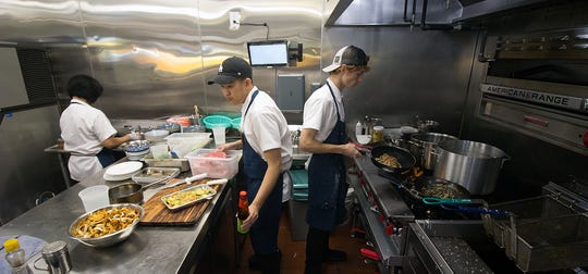 The kitchen at Ba Sa Restaurant bustles with activity.