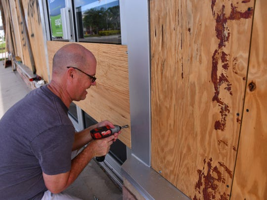 People were out Friday stocking up on food and supplies, putting up plywood and shutters and preparing for a hurricane. Mark Walker was helping his wife Jane board up Atlantic Furniture on Eau Gallie Blvd. Thew new owners were boading up before heading out to prepare their home for Dorian.