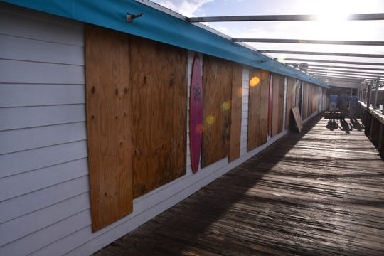 The shops at the Cocoa Beach Pier are all boarded up, as workers head out with plywood to board up the doors. Brevard County residents were busy Saturday preparing for the arrival of Hurricane Dorian, its path still uncertain at this time.