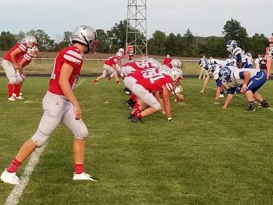 Buckeye Central lines up before a snap against Crestline.