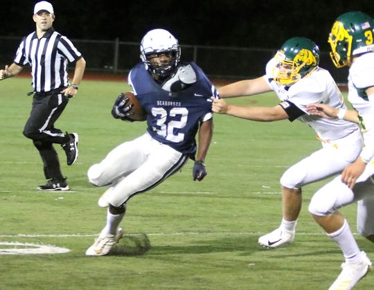 Burlington's Kai Schmidt tries to break free for some extra yardage during the Seawolves' season-opening loss to Burr and Burton on Friday night at Buck Hard field.