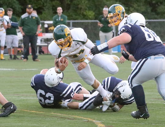 Burr and Burton quarterback Joey McCoy dives for a first down early in the Bulldogs' season-opening 35-7 win over the Seawolves.
