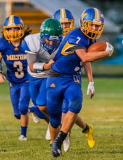 Milton's #7 Caleb Barnier tries to escape Colchester's defense during their football matchup in Milton on Friday, August 30, 2019.