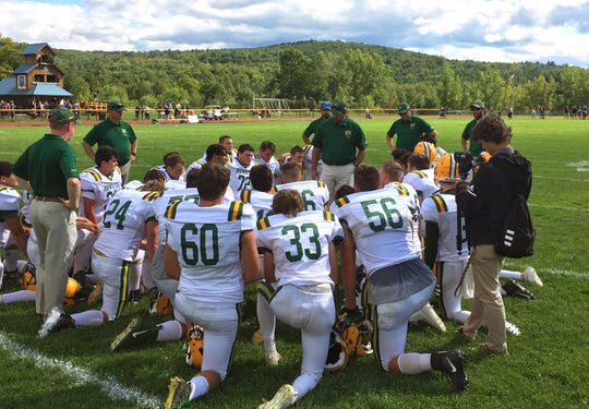 BFA-St. Albans coach Geoff Murray addresses his team after their 12-8 win against Mount Mansfield in high school football in Jericho on Saturday, Aug. 31, 2019.