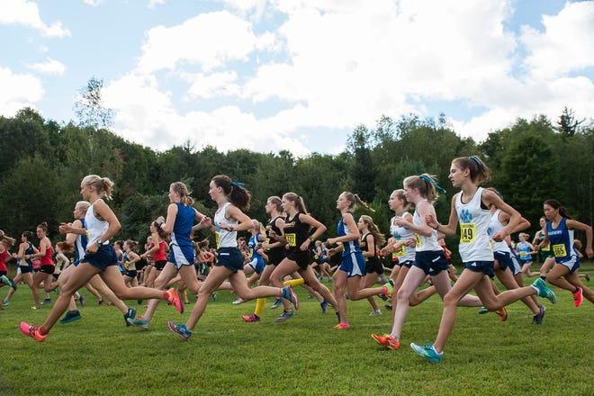Races make their way down the course during the Essex Invitational cross country meet at the Essex Tree Farm on Saturday afternoon August 31, 2019 in Essex, Vermont.