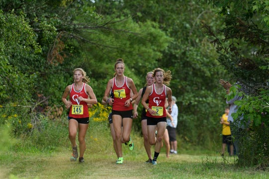 CVU leads the pack of runners during the Essex Invitational cross country meet at the Essex Tree Farm on Saturday afternoon August 31, 2019 in Essex, Vermont.