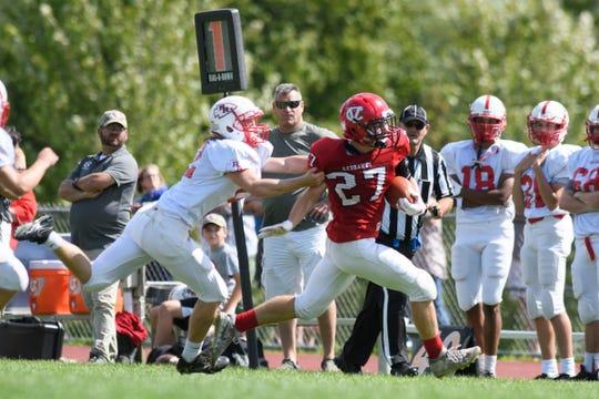 Rutland's Brady Kenosh (12) tackles CVU's Seth Boffa (27) during the high school football game between the Rutland Raiders and the Champlain Valley Union Redhawks at CVU High School on Saturday afternoon August 31, 2019 in Hinesburg, Vermont.