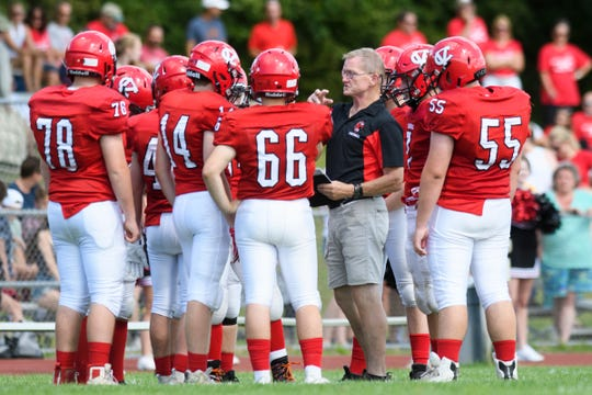 CVU head coach Rahn Fleming talks to the team during a time out in the high school football game between the Rutland Raiders and the Champlain Valley Union Redhawks at CVU High School on Saturday afternoon August 31, 2019 in Hinesburg, Vermont.