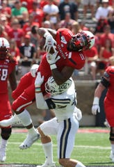 Aug 31, 2019; Lubbock, TX, USA; Texas Tech Red Raiders tight end Donta Thompson (11) is upended by Montana State Bobcats defensive back Brayden Konkol (11) in the first half at Jones AT&T Stadium. Mandatory Credit: Michael C. Johnson-USA TODAY Sports
