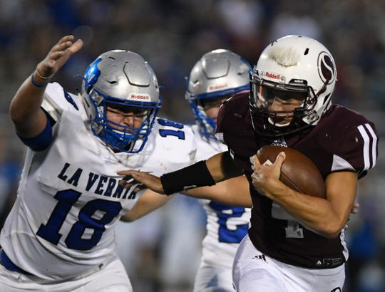 Sinton's Rene Galvan runs with the ball at the game against La Vernia, Friday, Aug. 30, 2019, at Sinton High School. Galvan is a quarterback for the team.
