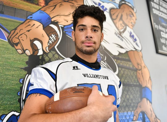 Williamstown defensive end Aaron Lewis poses for a photo inside the Frank Fucetola Field House on Friday, August 30, 2019.