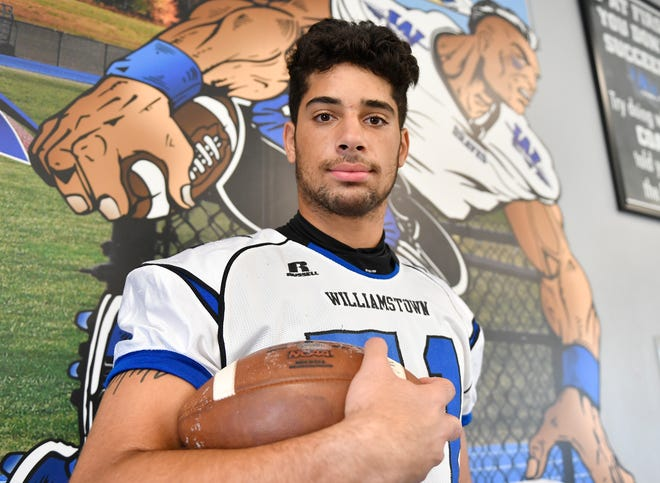 Williamstown defensive end Aaron Lewis poses for a photo inside the Frank Fucetola Field House on Friday last August. Lewis transferred to Rutgers on Monday.