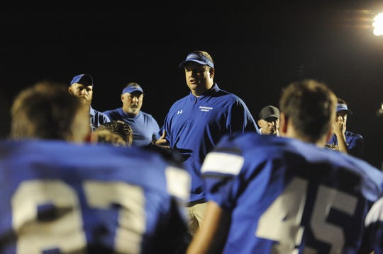 Southeastern head coach Evan Gallaugher talks to the team after a 36-7 win over Northwest at Southeastern High School in Chillicothe, Ohio on Friday Aug. 30, 2019.