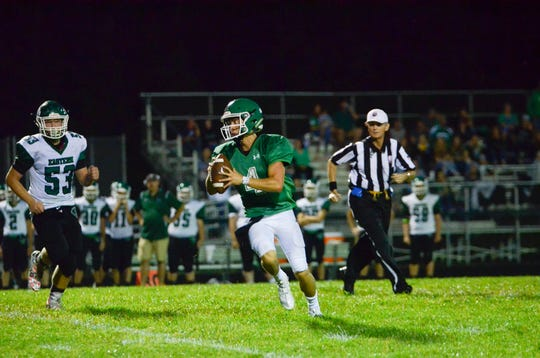 Huntington's Seth Beeler rolls out of the pocket during a 47-20 loss to Reedsville Eastern in Huntington Township, Ohio, on August 30, 2019.