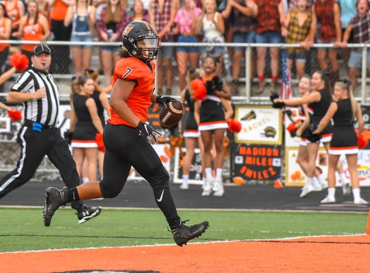 Ryle running back Kyle England runs into the endzone against Conner on Friday, Aug. 30,  2019, at Ryle High School.