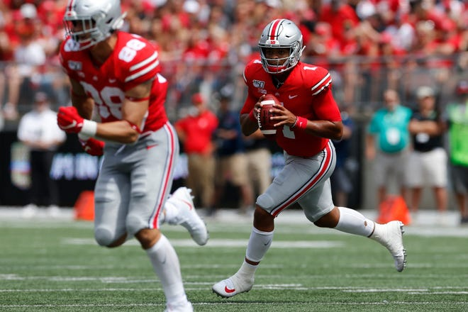 Ohio State quarterback Justin Fields looks for an open receiver against Florida Atlantic during the first half of an NCAA college football game Saturday, Aug. 31, 2019, in Columbus, Ohio.