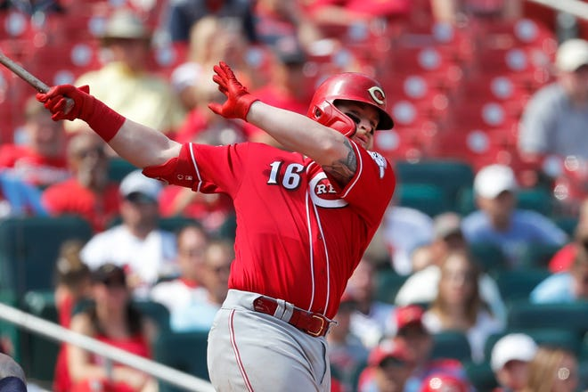 Cincinnati Reds' Tucker Barnhart follows through on a three-run double during the eighth inning in the first baseball game of a doubleheader against the St. Louis Cardinals, Saturday, Aug. 31, 2019, in St. Louis.