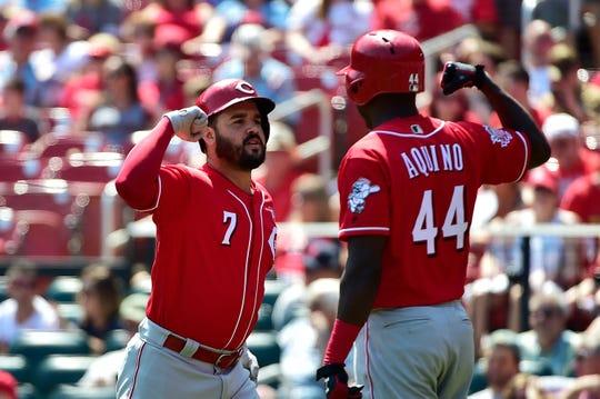 Reds third baseman Eugenio Suarez is congratulated by right fielder Aristides Aquino after hitting a two-run home run off of Cardinals starting pitcher Dakota Hudson.