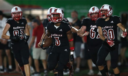 La Salle running back Gi'Bran Payne (3) celebrates a touchdown in the second half against Lakota West, Friday, Aug. 30, 2019.