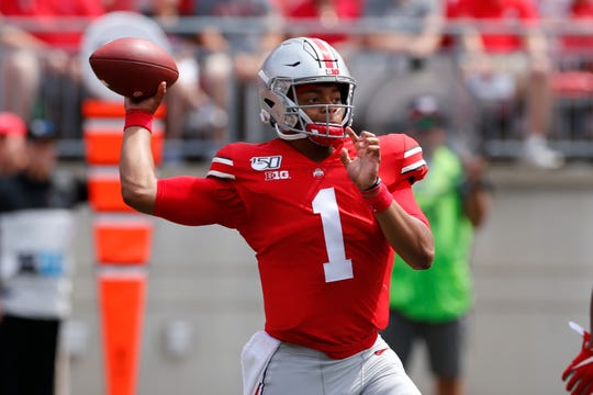 Ohio State quarterback Justin Fields throws a pass against Florida Atlantic during the first half of an NCAA college football game Saturday, Aug. 31, 2019, in Columbus, Ohio. (AP Photo/Jay LaPrete)