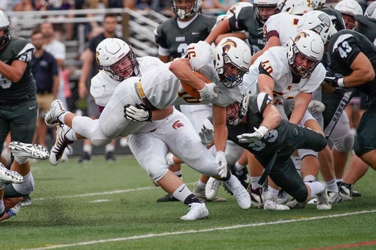 Turpin running back Reece Evans dives for a touchdown in Friday's varsity football game at Lakota East.