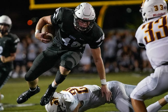 Lakota East running back Charlie Kenrich evades Turpin defenders during a run in Friday night's matchup Aug. 30, 2019.